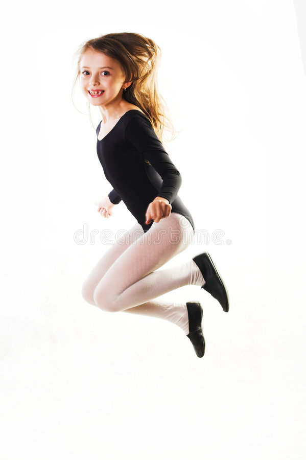 Child jumping for joy stock images
