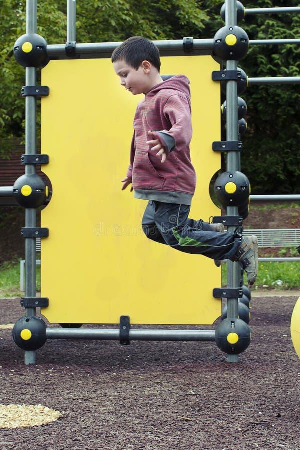 Child Jumping At Playground Stock Photo