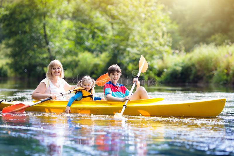 Child on kayak. Kids on canoe. Summer camping stock images