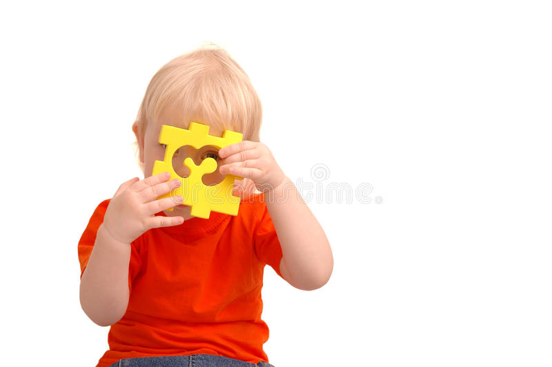 Download Child Keeps Puzzle With Numeral And Stock Image - Image of little, hair: 9469315