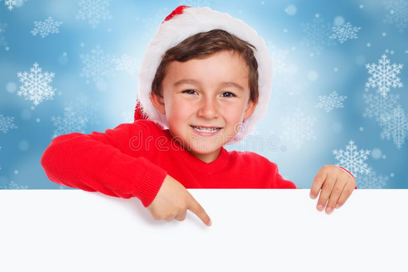 Child kid boy Christmas Santa Claus pointing happy empty banner copyspace royalty free stock photos