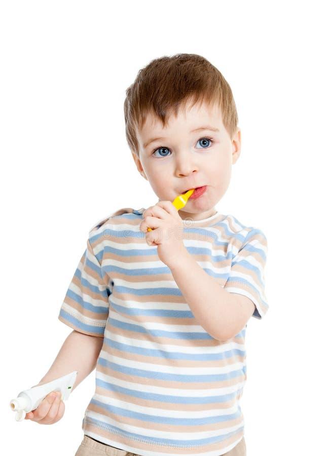 Child kid brushing teeth. Child kid boy brushing teeth isolated on white royalty free stock images