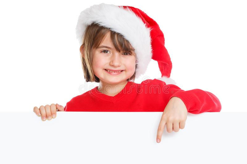 Child kid girl Christmas Santa Claus pointing happy empty banner copyspace stock image