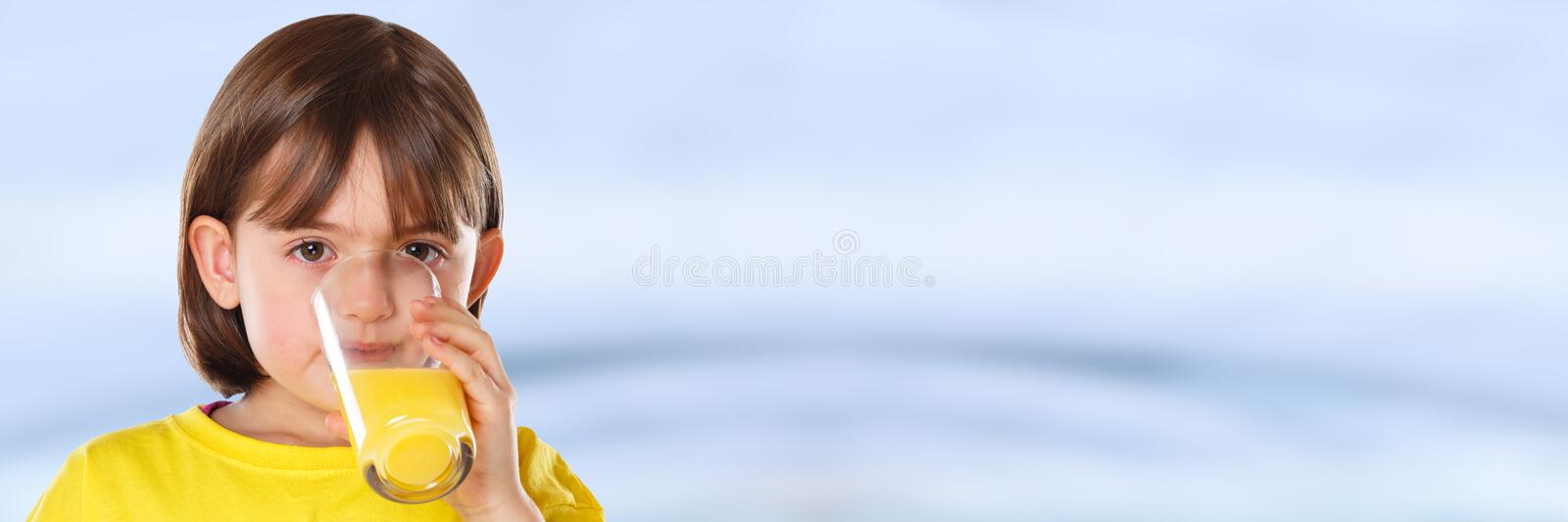 Child kid girl drinking orange juice healthy eating copyspace copy space banner stock images