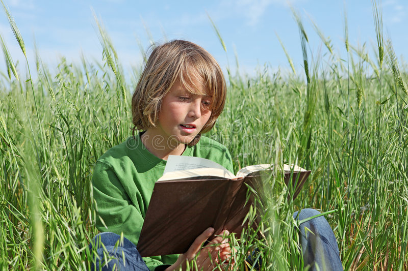 Child or kid reading book royalty free stock photography
