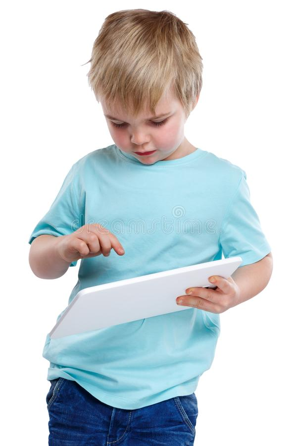 Child kid young little boy typing showing on tablet computer int. Ernet digital royalty free stock photo