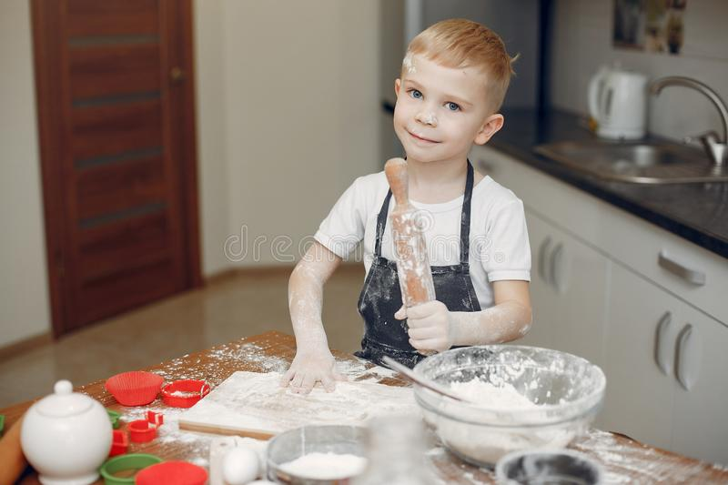 Little boy cook the dough for cookies stock photography
