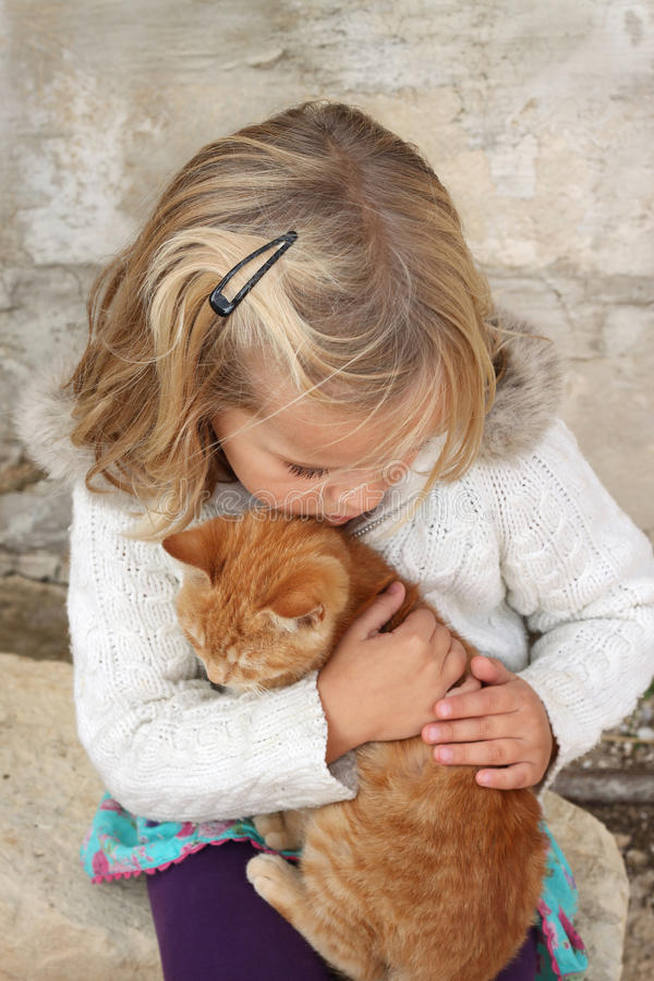 Child with kitten stock images