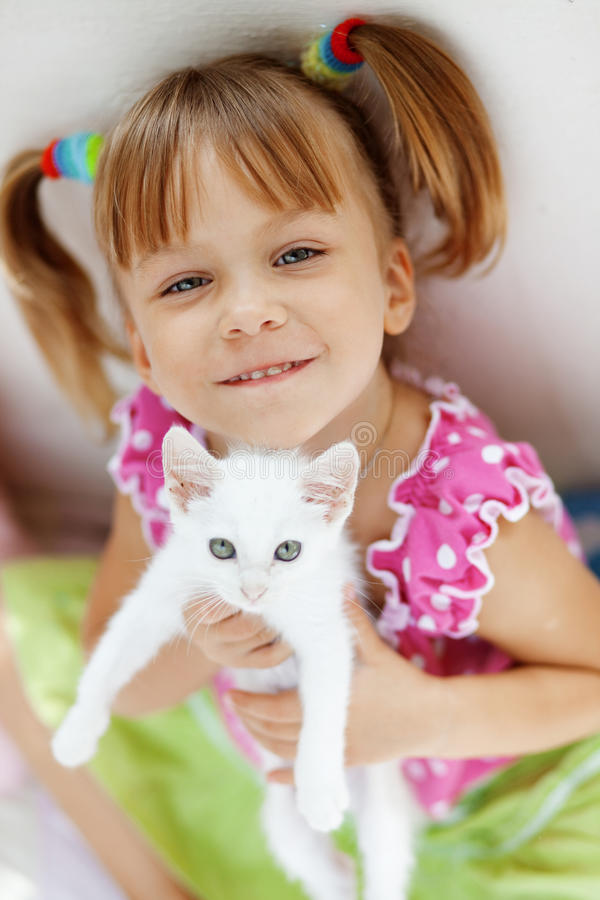 Child with kitty stock photo