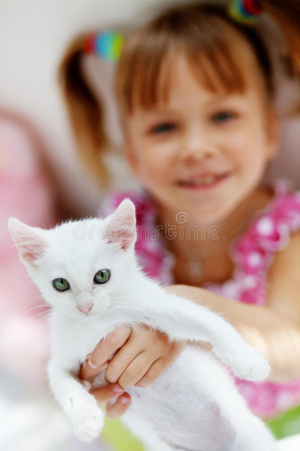 Child with kitty. Portrait of adorable child with kitten royalty free stock photography