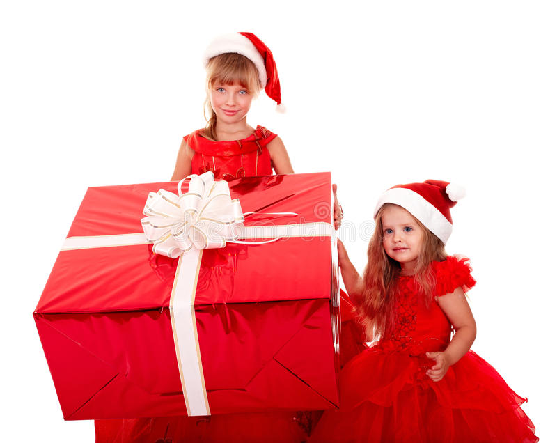 Child l in christmas hat with gift box. royalty free stock images
