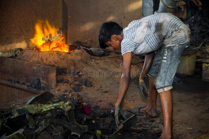 Bangladesh - August 6, 2019: A child labors working in unsafe, risky and hazardous condition without any precaution at Madhabdi,. A child labors working in royalty free stock photography