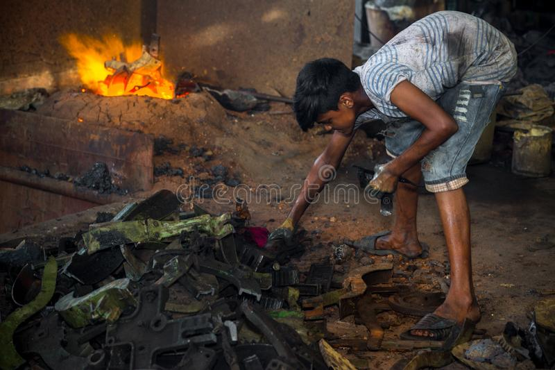 Bangladesh - August 6, 2019: A child labors working in unsafe, risky and hazardous condition without any precaution at Madhabdi,. A child labors working in stock photo