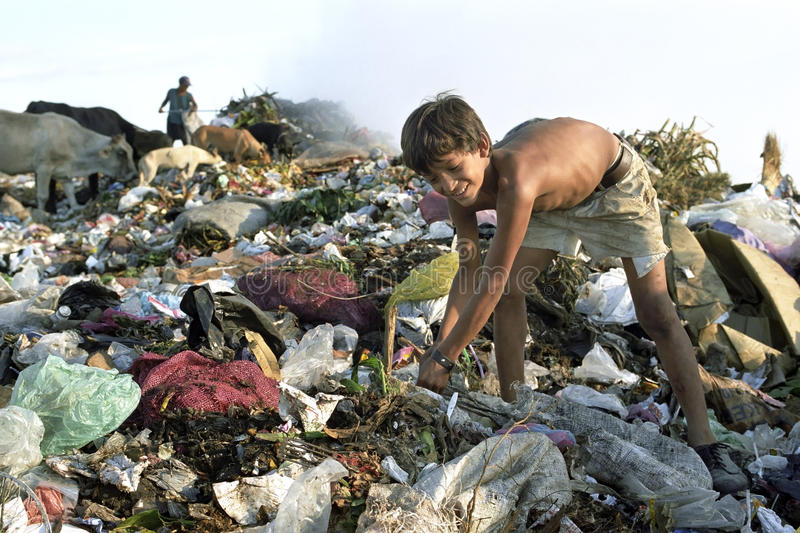 Child Labour Latino boy on landfill, Managua. Nicaragua, capital, city Managua an young child is working among the garbage in landfill Acahualinca in Managua to royalty free stock image