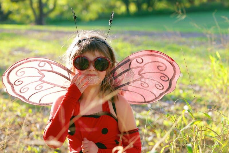 Child in ladybug costume stock photography