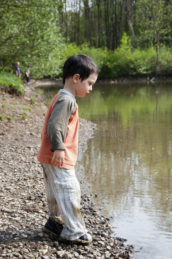 Download Child by lake stock image. Image of childhood, outdoor - 27724457