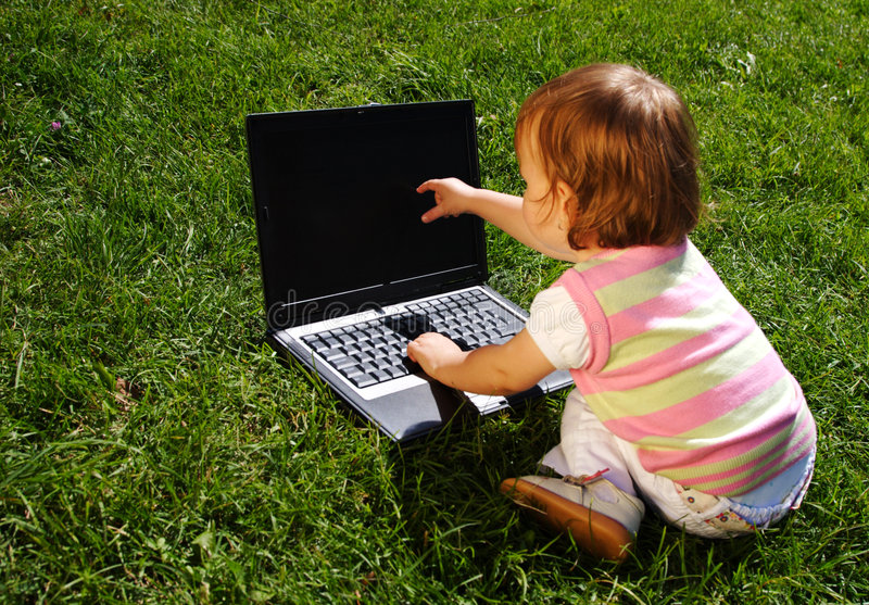 Download Child with laptop stock photo. Image of clever, field - 7437258
