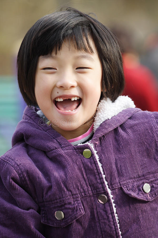 Child laughing stock image