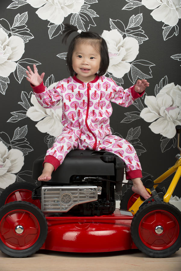 Child and lawn mower royalty free stock photo