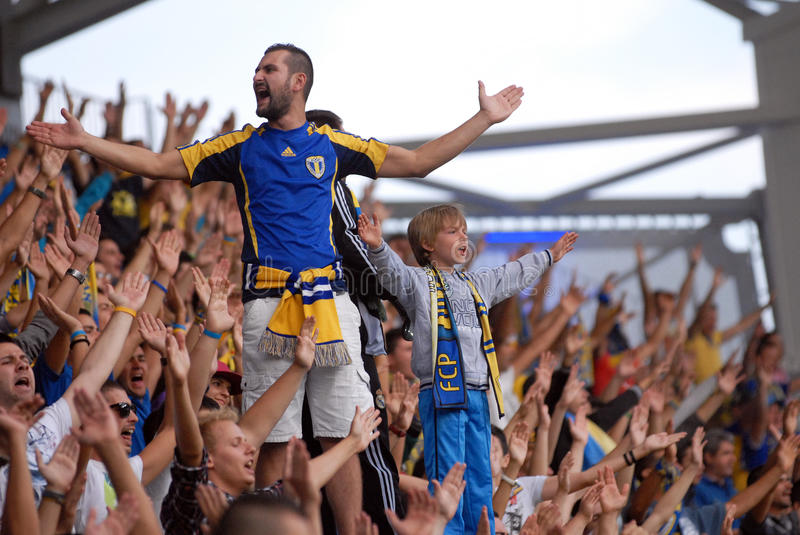Child leading football ultras. A child leads Petrolul football fans during the friendly game between Petrolul Ploiesti and Sahtior Donetsk on&th of September