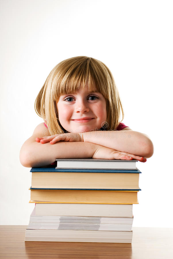 Child leaning on books royalty free stock photo