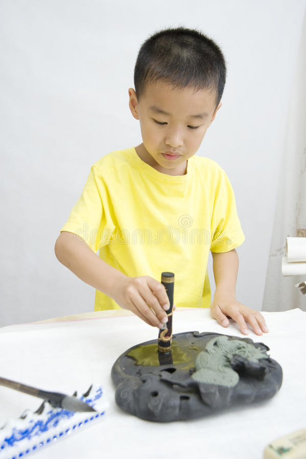 Download A Child  Learning Chinese Calligraphy Stock Photo - Image: 14405928
