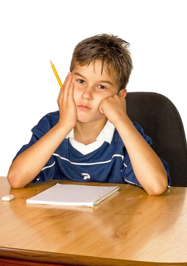 Child with learning difficulties. A frustrated, upset child, or child with learning difficulties stock image