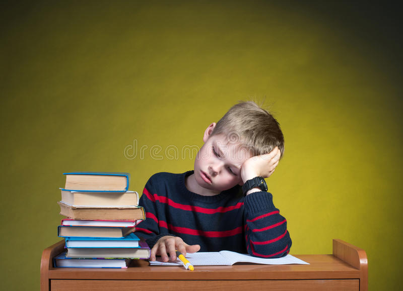 Child with learning difficulties. Doing homework. stock images