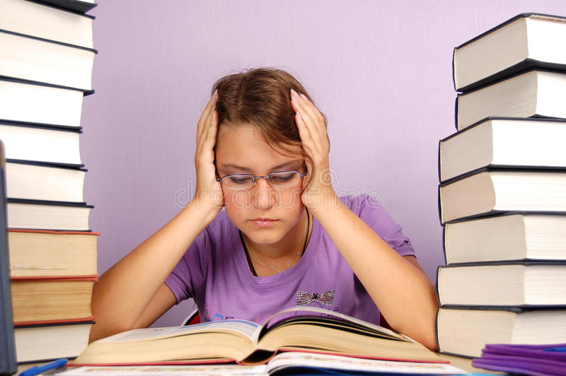 Child with learning difficulty. A frustrated, upset child, or child with learning difficulties royalty free stock images