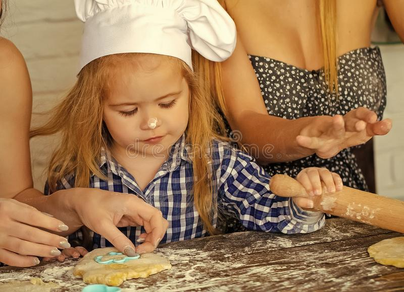 Child learning to cook royalty free stock photography