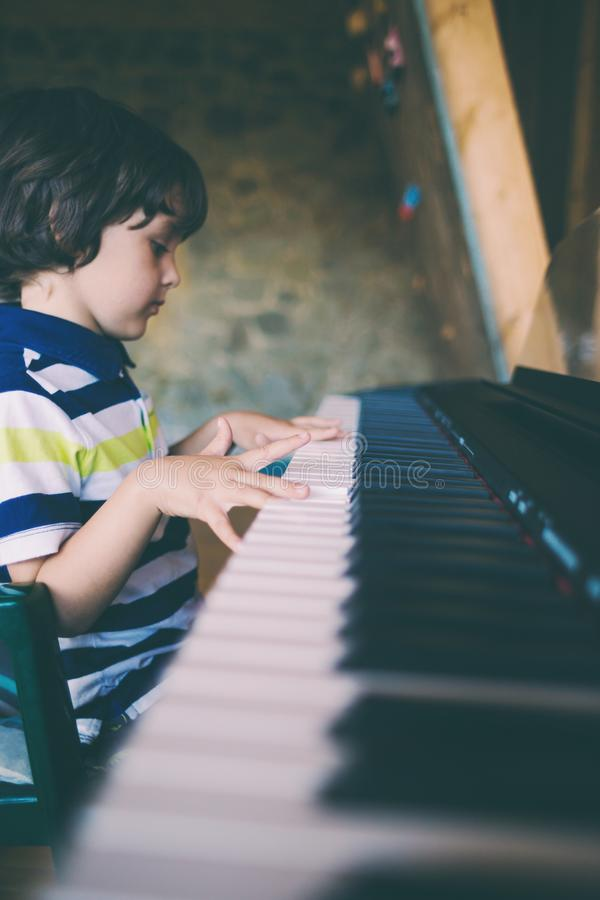 A child learns to play the piano royalty free stock image