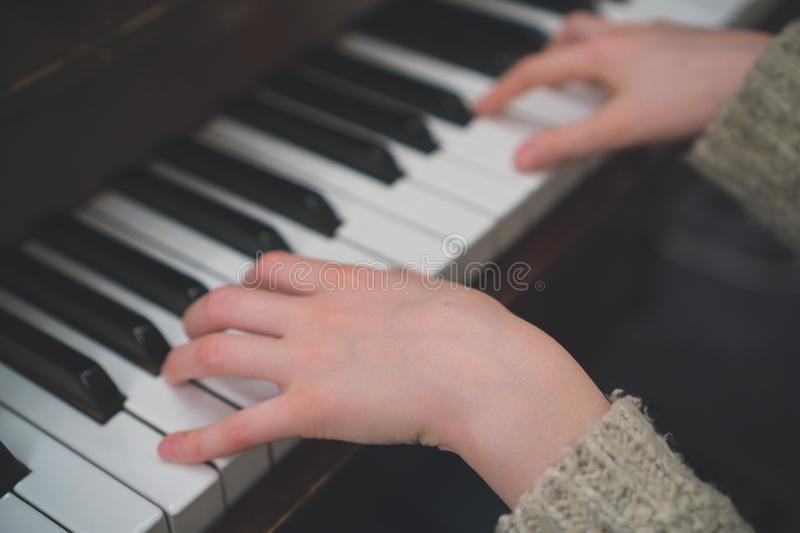 Child learns the piano. royalty free stock photography