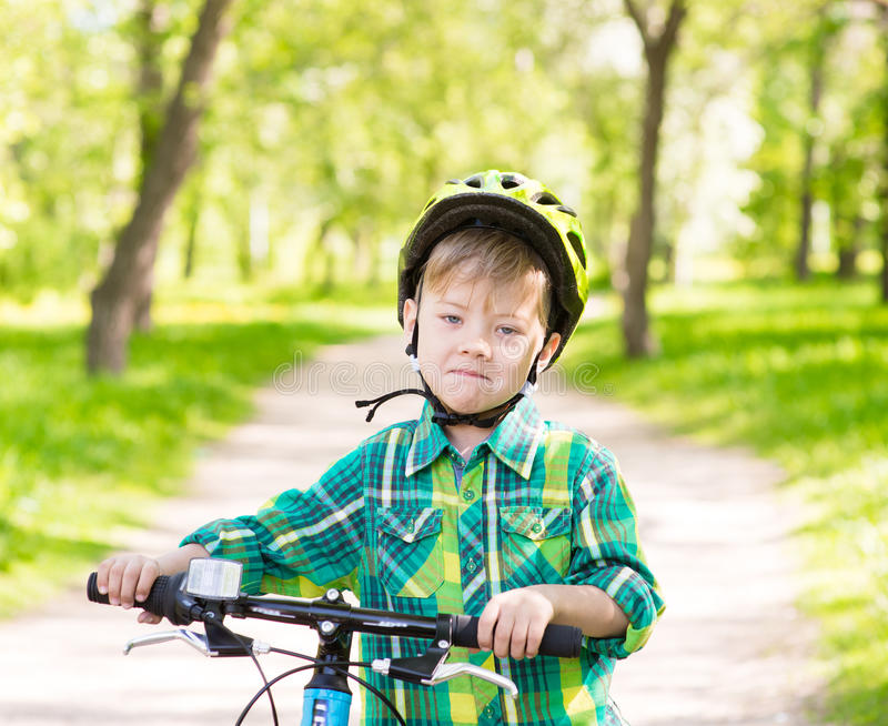 Child learns to ride a bike.  royalty free stock photography