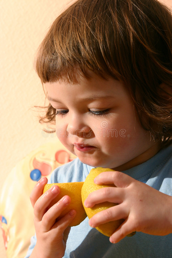 Child and lemons royalty free stock photo