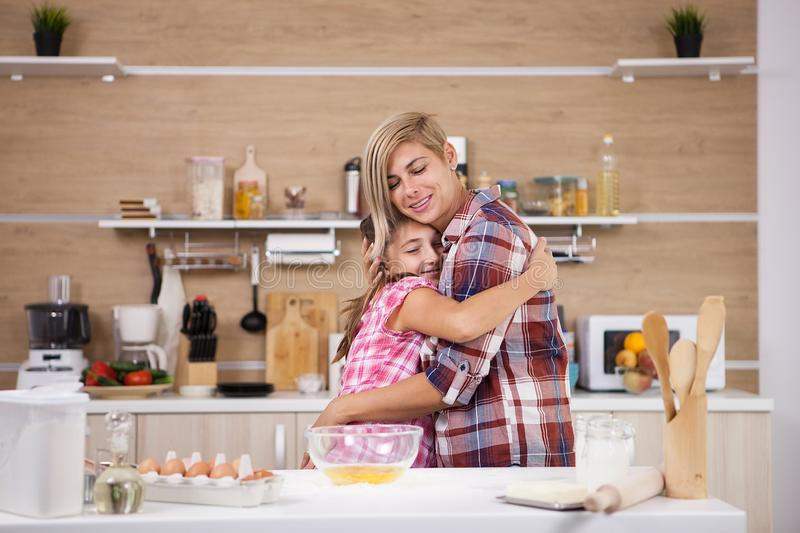Child leping mother prepare delicious food for both of them stock photos