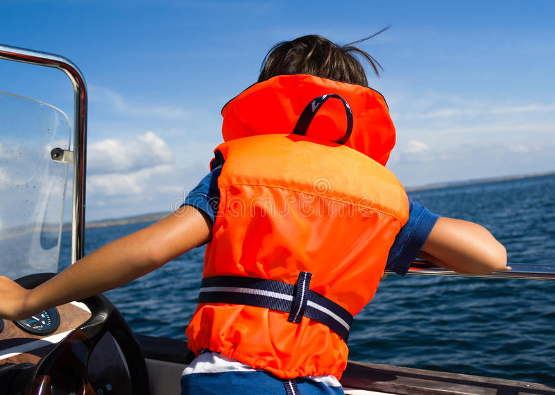 Child with life vest stock image