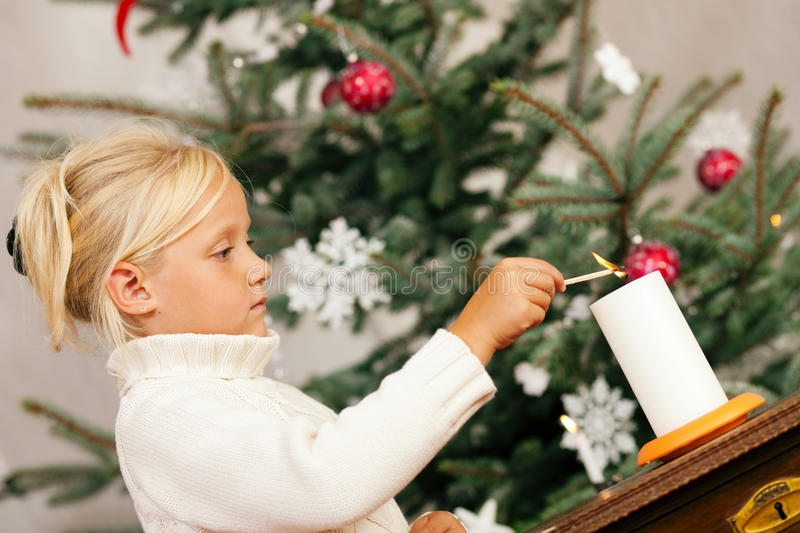 Child Lighting Christmas Candles Royalty Free Stock Image