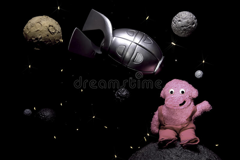 Child-like space scene with rocket and friendly alien stock photo