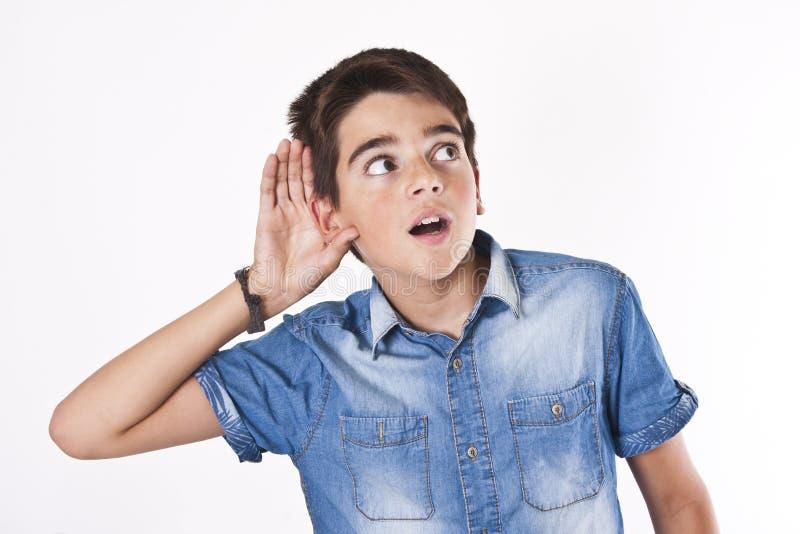Child listening stock photography