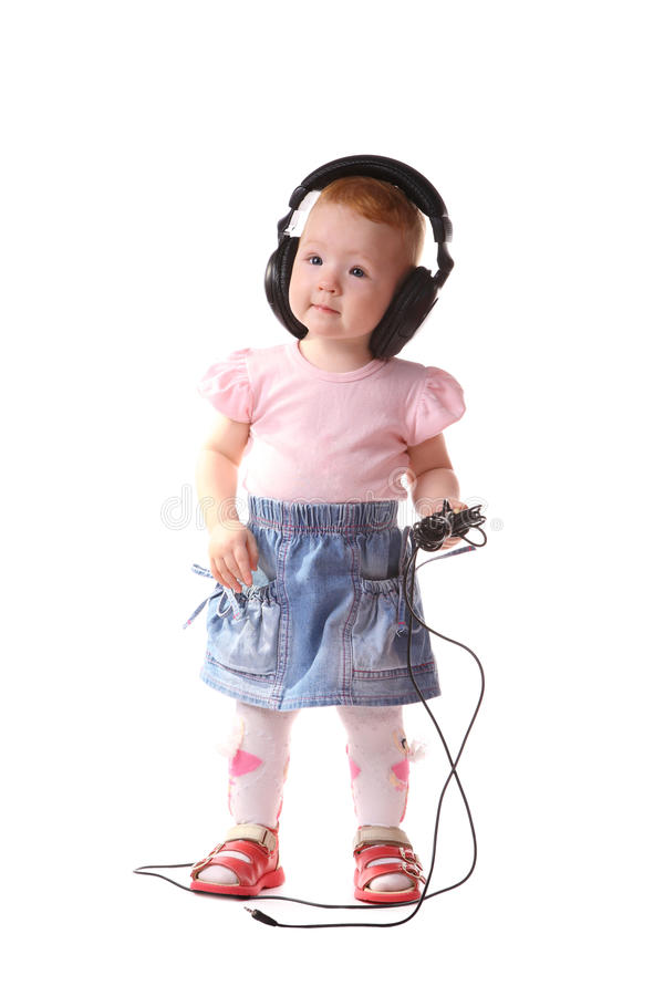 The child listens to music stock images