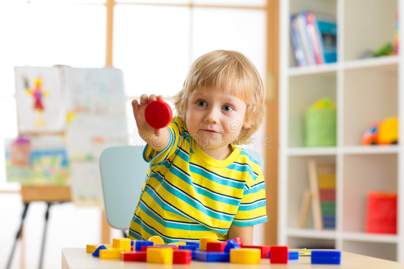 Child little boy learning shapes, early education and daycare concept royalty free stock images