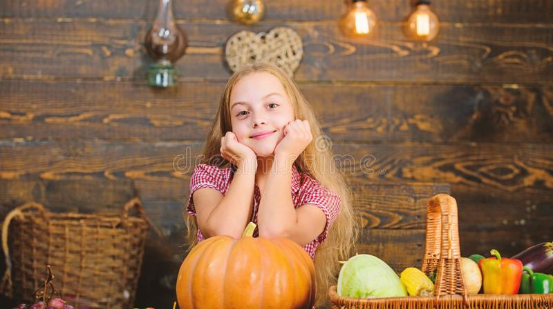 Child little girl enjoy farm life. Grow your own organic food. Organic gardening. Harvest festival concept. Girl kid at. Farm market with organic vegetables stock images