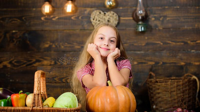 Child little girl enjoy farm life. Grow your own organic food. Organic gardening. Harvest festival concept. Girl kid at. Farm market with organic vegetables royalty free stock photo