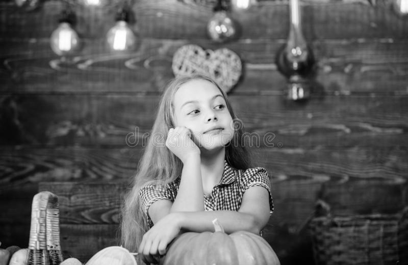 Child little girl enjoy farm life. Organic gardening. Harvest festival concept. Girl kid at farm market with organic. Vegetables. Grow your own organic food royalty free stock photo