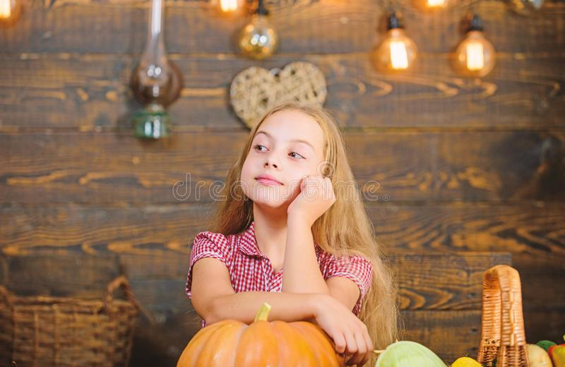 Child little girl enjoy farm life. Organic gardening. Harvest festival concept. Girl kid at farm market with organic. Vegetables. Grow your own organic food royalty free stock photography