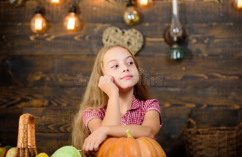 Child little girl enjoy farm life. Organic gardening. Harvest festival concept. Girl kid at farm market with organic. Vegetables. Grow your own organic food stock photos