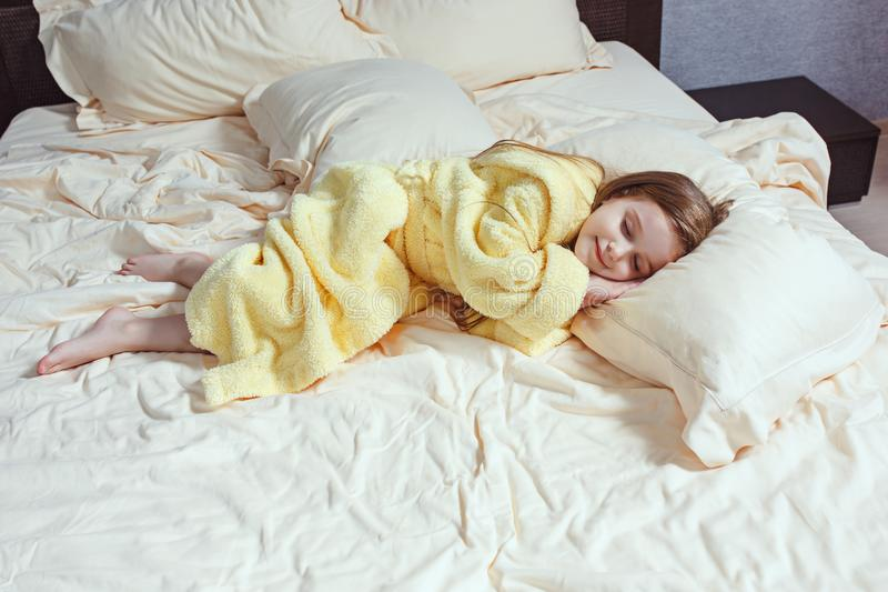 The child little girl sleeping in the bed stock photo