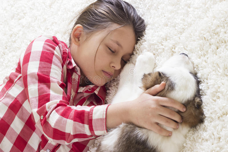 Child and little puppy royalty free stock images