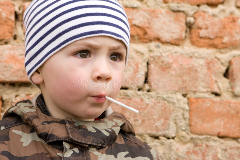 Download Child with Lollipop stock image. Image of staring, candy - 5215881
