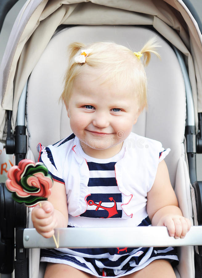 A child with a lollipop royalty free stock photos